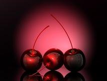 Red cherries. Artistic shot of three cherries Royalty Free Stock Images