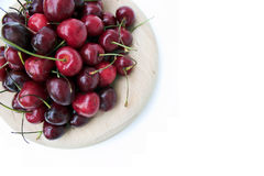 Red Cherries. Ripe Cherries - pure white background with space for copy Stock Photos