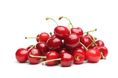 Red cherries. Pile of red cherries isolated on the white background Royalty Free Stock Photos