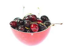 Red cherries. Red cherries in a red bowl Royalty Free Stock Photos