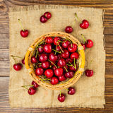 Red cherries in basket, сherry basket, red сherries on wooden Royalty Free Stock Images
