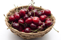 Red cherries in the basket Royalty Free Stock Images