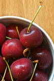 Red cherries in a bowl royalty free stock images