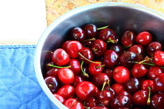 Red cherries in a bowl Stock Photography