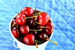 Red cherries in a bucket Stock Photo