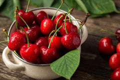 Red cherries, cherries on table, bowl with cherries, freshly pic Royalty Free Stock Photo