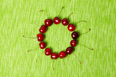 Red cherries in a circle Royalty Free Stock Photo