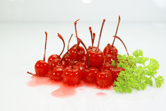 Red Cherries and Coriander. A background with a view of juicy red cherries with coriander leaves Stock Photo