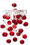 Red cherries falling in water Stock Images