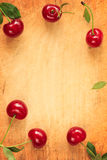 Red cherries frame/ border. Royalty Free Stock Image