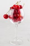 Red Cherries In Wine Glass Stock Image