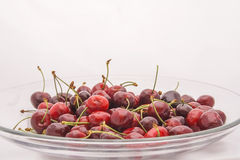 Red cherries in a glass bowl Stock Photos