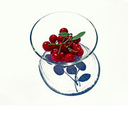 Red cherries on a plate. Red bright cherries on a glass plate Stock Photos