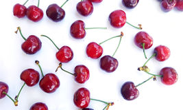 Red cherries scattered on white Stock Photos
