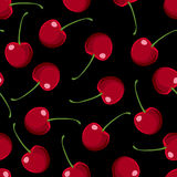 Red Cherries Seamless Pattern. Repeatable background with tasty red cherries. Ripe berries at black background Royalty Free Stock Images