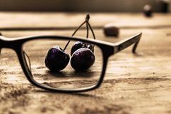 Cherries on glasses. stock images