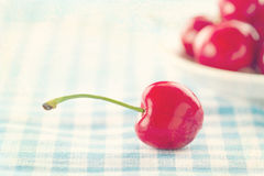 Red cherries on shabby chic blue background Stock Images
