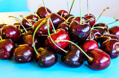 Red cherries. A small group of dark red cherries Stock Photos