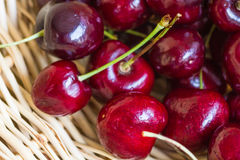Red Cherries. Sweet red cherries on a woven basket Royalty Free Stock Images