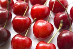Red cherries on white Royalty Free Stock Photography