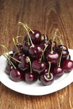 Red Cherries on White Dish Stock Photos