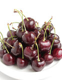 Red Cherries on White Dish Stock Images