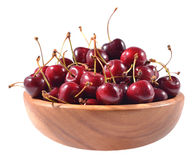 Red cherries in a wooden bowl on a white Royalty Free Stock Photo