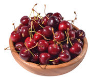 Red cherries in a wooden bowl on a white Royalty Free Stock Image