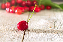 Red cherry close-up on a wooden table Stock Photography