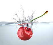 Red cherry falling into water and splashing. Stock Photography