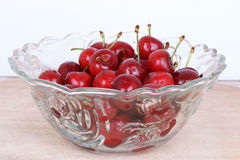 Red cherry fruit in glass bowl Royalty Free Stock Image