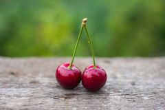 Red cherry fruits on wooden table background Royalty Free Stock Image