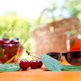 Red cherry and glass of juice Royalty Free Stock Images