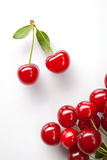 Red cherry with leaves on white Royalty Free Stock Image