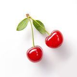 Red cherry with leaves on white Stock Image
