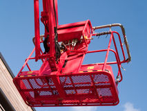 Red cherry picker machine Royalty Free Stock Photography