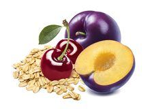 Red cherry, plum and oats isolated on white background royalty free stock image