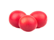 Red cherry plum. Three fresh and tasty red cherry plum on a white background Royalty Free Stock Photo