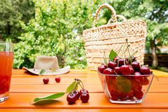 Red cherry and shopping bag Royalty Free Stock Photo