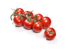 Red cherry tomatoes. On a twig Stock Photo