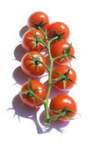 Red cherry tomatoes. On a white Royalty Free Stock Photography