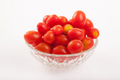 Red cherry tomatoes in a bowl Royalty Free Stock Images
