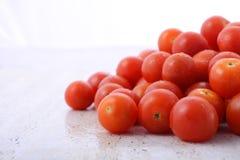 Red cherry tomatoes closeup. Stock Photos