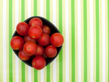 Red cherry tomatoes in dark bowl Stock Photos