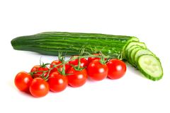 Red cherry tomatoes and green cucumber Stock Images