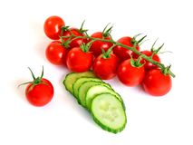 Red cherry tomatoes and green cucumber Stock Photo
