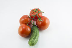 Red cherry tomatoes and green cucumbers Royalty Free Stock Photos