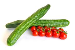 Red cherry tomatoes and green cucumbers Stock Photography