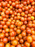 Red Cherry Tomatoes Group For Sale In Market Stock Photos