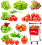 Red cherry tomatoes and lettuce leaves Stock Photo